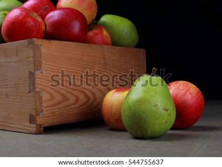 Apples and pears. Wooden box with juicy fruits.