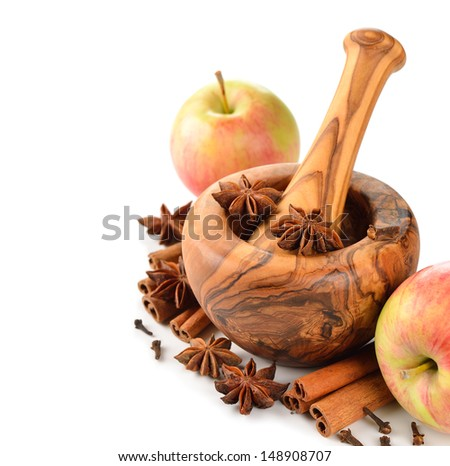 Apples and spices on a white background