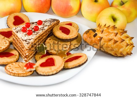apples and sweets on  sunlight background close-up