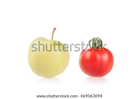 apples and tomatoes on white background