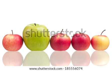Apples different in the size lie in a row isolated on white background