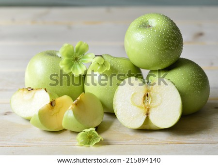 Apples fresh green juicy wet on the table. - stock photo