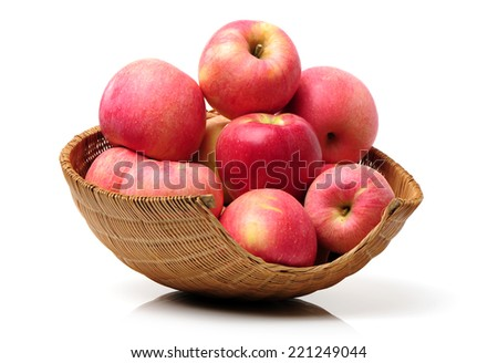 Apples in a basket on a white background - stock photo