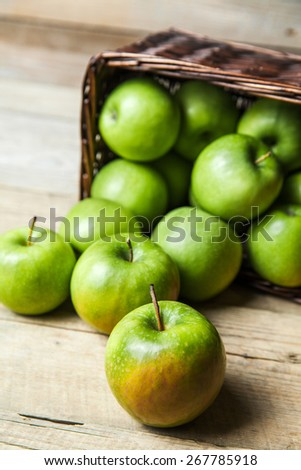 apples in a bowl on wooden background. Fruit - stock photo