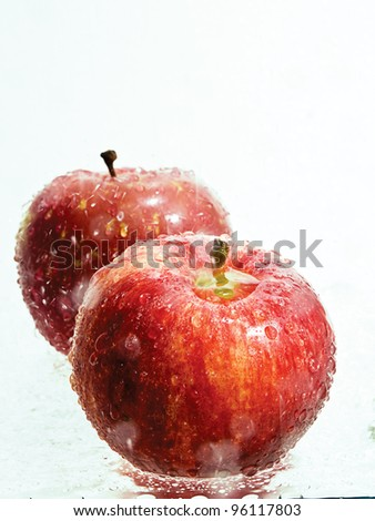 Apples in a splash of fresh water - stock photo