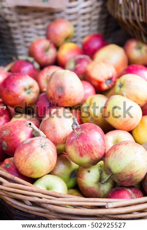 Apples in basket at the market, autumn harvest, ripe fruits