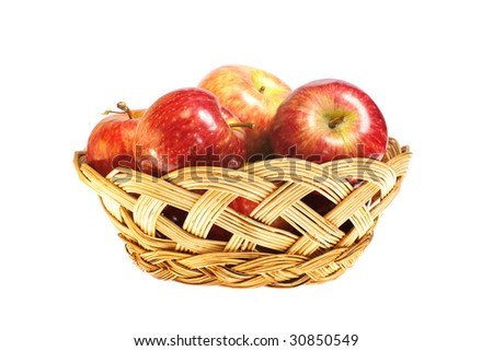 apples in basket isolated on white background