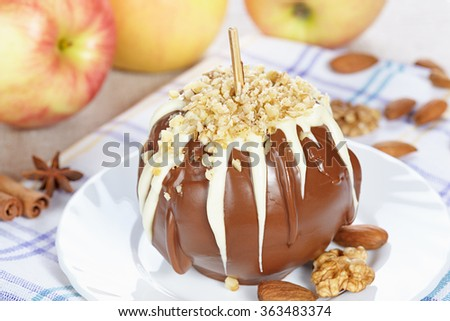 Apples in chocolate with nuts - stock photo