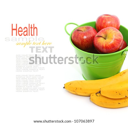 Apples in the green tin bucket with banana isolated on white