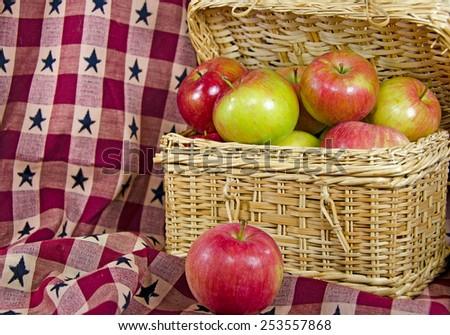 apples in wicker picnic basket - stock photo