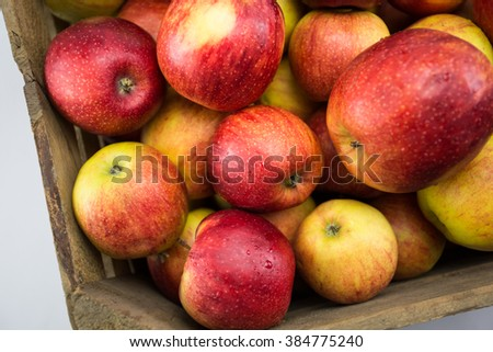Apples in wooden box.