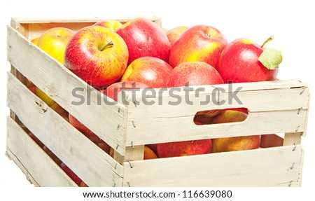 apples in wooden box isolated on white background