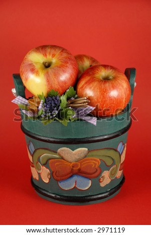 Apples in wooden buckets painted in Norwegian Rosemaling style.