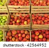 apples in wooden crates on market - stock photo