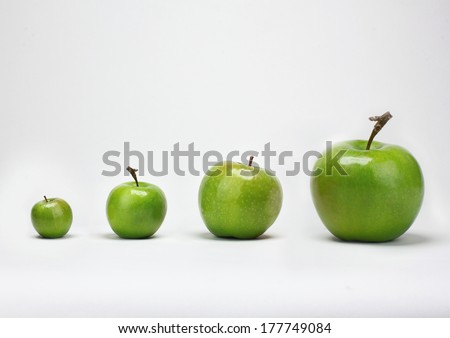 Apples on a white background of various sizes - stock photo