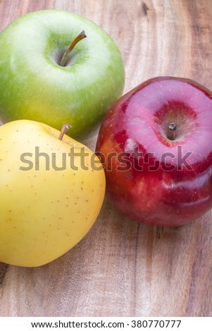 apples on a wooden board, top view, horizontal layout. fruit color image with space for writing