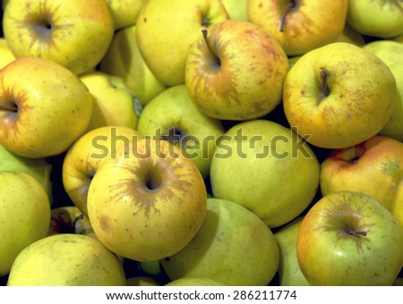 apples on display in a supermarket - stock photo