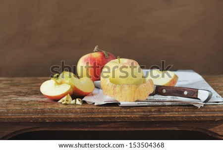apples on on the brown background - stock photo