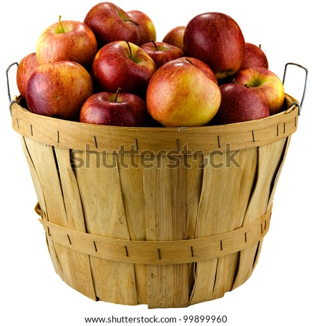Apples sitting in a wooden basket isolated on white background. - stock photo