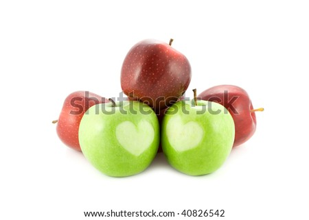 apples with a heart isolated on white