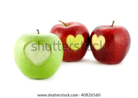 apples with a heart isolated on white - stock photo