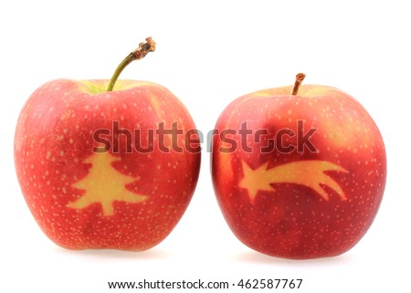 apples with christmas symbols isolated on the white background
