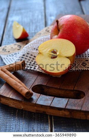 Apples with cinnamon on a dark background - Still Life