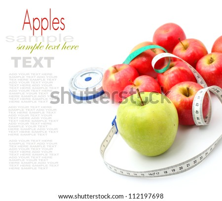 Apples with measuring tape on white background - stock photo