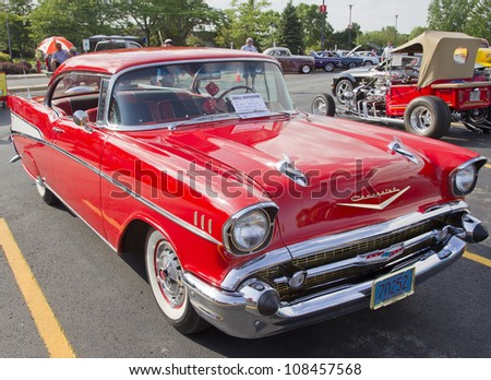 APPLETON, WI - JULY 21: Red 1957 Chevy Chevrolet Bel Air Two Door at the 18th Annual WVBO Classic Car Show and Cruise at Fox Valley Technical College on July 21, 2012 in Appleton, Wisconsin. - stock photo