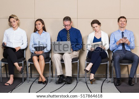 Applicants in Formal Clothes Sitting and Waiting