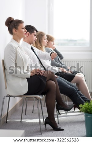 Applicants waiting for job interview in corporation