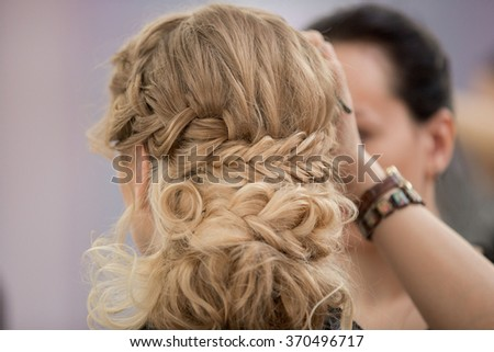 Application of wedding makeup. Preparation of the bride. Boho style. Ease of braided hair braids.