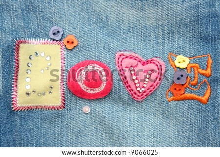 """Application on a fabric  """"LOVE """" - stock photo"""