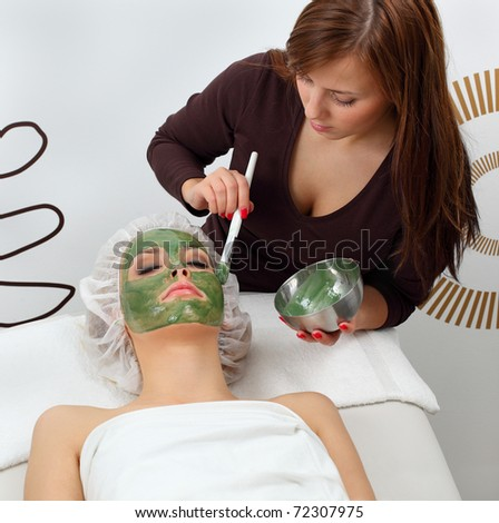 Application seaweed mask in professional studio