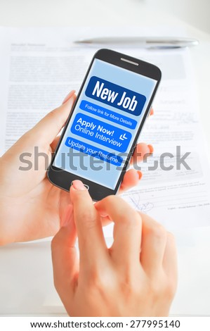 Apply for a job via smartphone or mobile device - stock photo