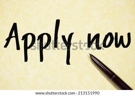 apply now text write on paper  - stock photo