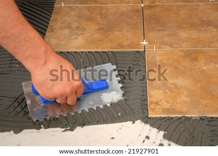 applying adhesive with a tool for grind stone
