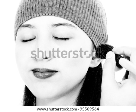 Applying Blusher Cosmetic Make Up To A Young Girl - stock photo