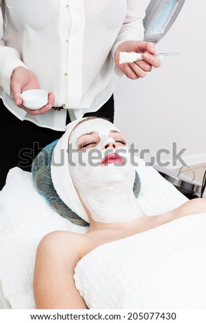 applying cosmetic mask at beauty salon