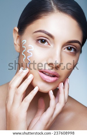 Applying cream concealer - stock photo
