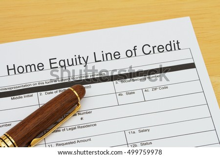 Applying for a Home Equity Line of Credit, Home Equity Line of Credit application form with a pen on a desk