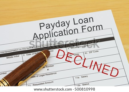 Applying for a Payday Loan Declined, Payday loan application form with a pen on a desk with an declined stamp