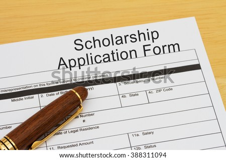 Applying for a Scholarship, Scholarship Application Form with Pen on a desk