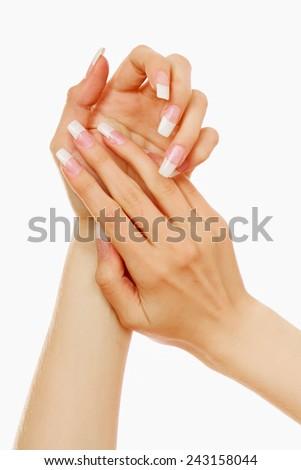 Applying hand cream - stock photo
