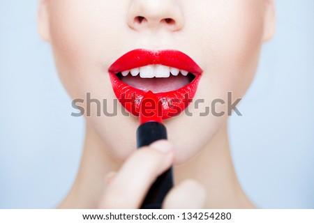 Applying lipstick - stock photo