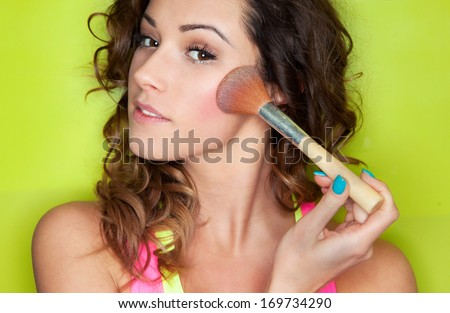 Applying make up concept, woman with cosmetic brush - stock photo