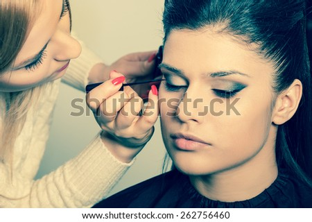 Applying perfect makeup - stock photo