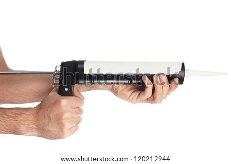 Applying silicone with caulking gun isolated on white, clipping path included - stock photo