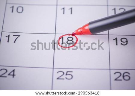Appointed day on the calendar with a pen - stock photo