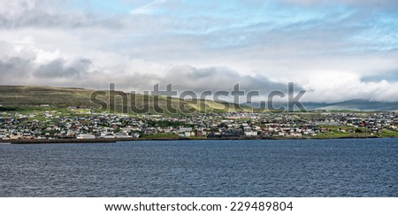 Approach to Torshavn, the capital of the Faroe Islands, which are located between Iceland and Scotland, United Kingdom - stock photo